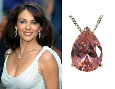 Which of your favorite celebrities have been photographed with elizabeth hurley wearing a pear shaped pink sapphire solitaire pendant aloadofball Image collections