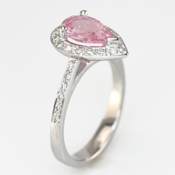 Pear shaped pink sapphire ring halo design with tapered pave shank