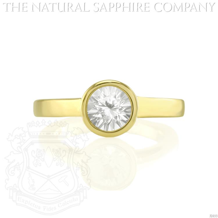 white sapphire ring in yellow gold