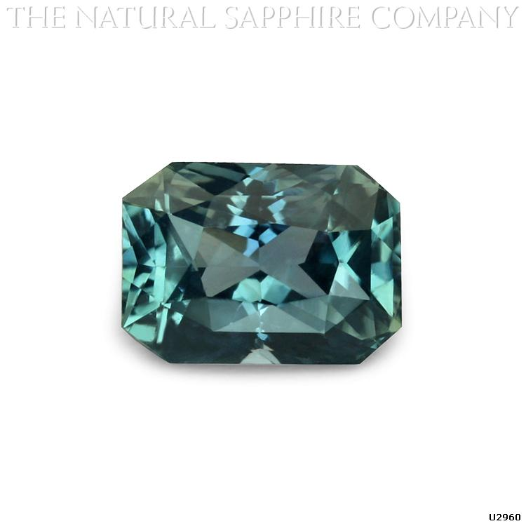 U2960 is a beautiful bluish green radiant cut sapphire.
