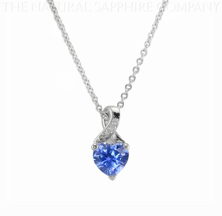 Symbols of valentines day natural untreated heart shape blue sapphire and diamond pendant aloadofball Image collections