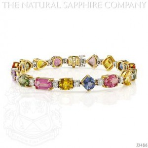 22.64ctw multi-colored sapphire bracelet with 18k yellow and white gold
