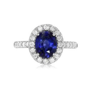 A blue sapphire pave diamond ring