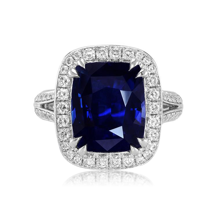 A blue sapphire ring with double claw prongs