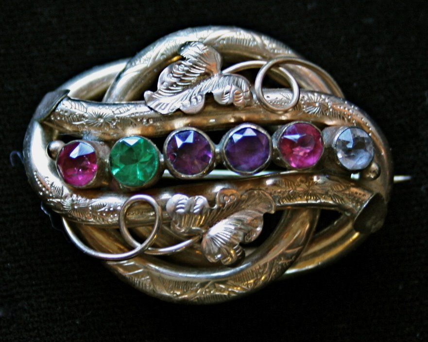antique regard brooch