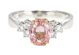 side stone padparadscha sapphire ring