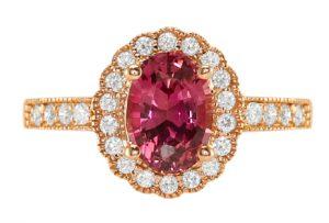 oval reddish-pink sapphire ring