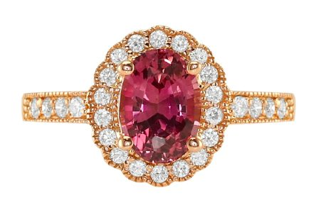 oval reddish-pink sapphire ring