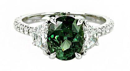 oval green sapphire diamond ring