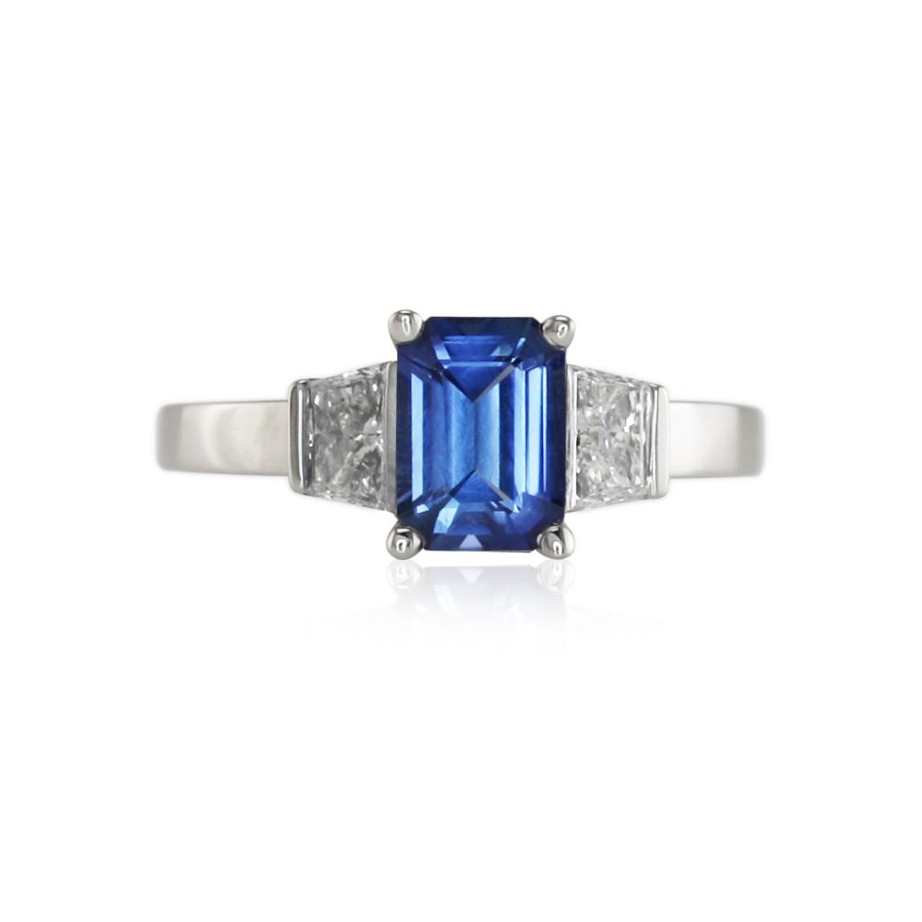 Emerald Cut Blue Sapphire Three Stone Ring Image Description