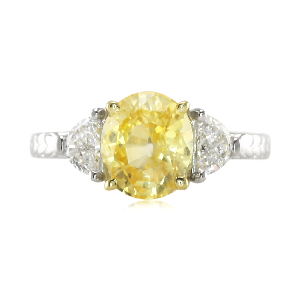 a lovely oval yellow sapphire and diamond ring the